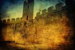 Grunge medieval castle. Dark background Royalty Free Stock Photo