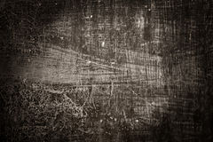 Grunge metal background. Textured metal plate with scratches and arbrasions. Vignetted Royalty Free Stock Image