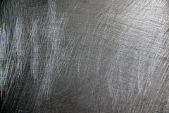 Grunge metal background. Scratched metal textured grunge background Royalty Free Stock Photo