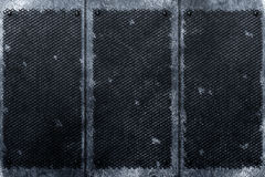 Grunge metal background. rivet on black grille and metal plate. Stock Photo