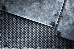 Grunge metal background. rivet on metal plate and black grille. Royalty Free Stock Images