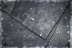 Grunge metal background. rivet on metal plate and black grille. Stock Photos