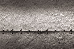 Grunge metal background. rivet on metal plate. Stock Images