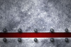 Grunge metal background. rivet on metal plate and red carbon fib Stock Photo