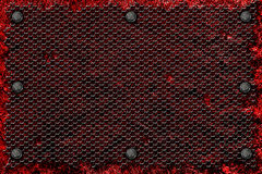 Grunge metal background. rivet on red metal plate and black gril Stock Images