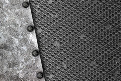 Grunge metal background. rivet on white metal plate and black gr Stock Photos