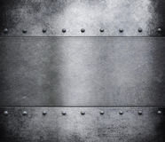Grunge metal background with rivets Royalty Free Stock Images