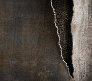 Grunge metal background with torn edges stock photography