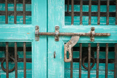 Grunge metal door with padlock Royalty Free Stock Images