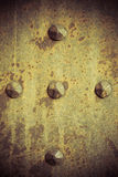 Grunge metal plate armour texture with rivets Stock Image