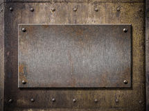 Grunge metal plate over rusty background Royalty Free Stock Photo
