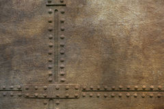 Grunge metal plate with rivets Stock Image