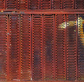 Grunge metal wall background or texture. Grunge rusted metal wall made of grating. May be used as background or texture Royalty Free Stock Photos