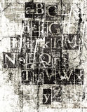 Grunge Metallic Font. A metallic font on a grunge scratched surface Royalty Free Stock Photos