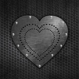 Grunge metallic love heart on mesh Stock Photos