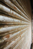 Grunge metallic roller closed shutter of shop. Side view of grunge metallic roller closed shutter of shop Royalty Free Stock Images