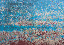 Grunge metallic texture. Grunge, scratched metallic texture in blue, yellow and red colors Royalty Free Stock Photography