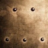 Grunge metalu złocisty brown talerz nituje śruby tła teksturę zdjęcia stock