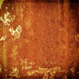 Grunge metalu zrudziała i pomarańczowa tekstura dla Halloween tła Zdjęcia Royalty Free