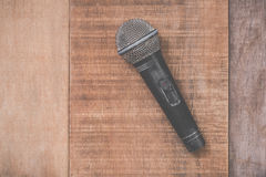 Grunge microphone on wooden background Stock Photo