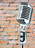 Grunge Mike. Retro Mic Against Brick Wall Royalty Free Stock Photos