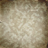 Grunge military background with a texture of paper. Grunge military background. Camouflage pattern on a paper texture Royalty Free Stock Photos