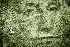 Grunge Money. A grunge textured background of a close up George Washington from a US dollar bill. Represents the decline of the American dollar / Values / Stock Photo
