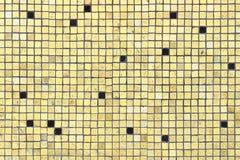 Grunge mosaic tiles. Grunge yellow small mosaic tiles wall Stock Photo