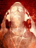Grunge Music. An Abstract textured grunge background with a person listening to music Royalty Free Stock Image