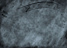 Grunge Music Note Background. Blue and black grunge type background with wavy music staff lines and several notes Stock Images
