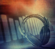 Grunge musical background. Grunge musical abstract background, headphones Stock Photo