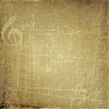 Grunge musical background with gold notes Stock Photos