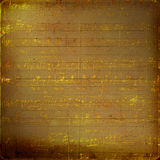 Grunge musical background with gold notes Stock Photo