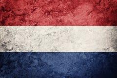 Grunge Nederland flag. Nederlands flag with grunge texture. Stock Photography