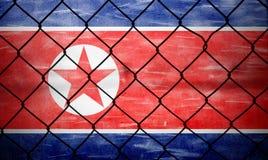 Grunge North korea flag with fence background Stock Photo