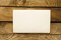 Grunge Note Paper On Wooden Background Stock Photography