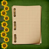 Grunge notebook with sunflowers Stock Images