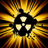 Grunge nuke sign. Abstract background with exploding rays nuclear hazard symbol Royalty Free Stock Image