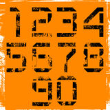 Grunge numbers. Grunge display numbers on orange Royalty Free Stock Image