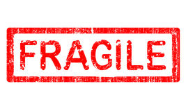 Grunge Office Stamp - FRAGILE. Grunge Office Stamp with the word FRAGILE in a grunge splattered text. (Letters have been uniquely designed and created by hand Stock Photo