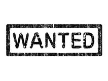 Grunge Office Stamp - WANTED. Grunge Office Stamp with the words WANTED in a grunge splattered text. (Letters have been uniquely designed and created by hand Stock Photos