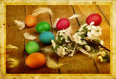 Grunge old carved postcard with eggs to celebrate Easter Royalty Free Stock Image