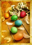Grunge old carved postcard with eggs to celebrate Easter Stock Images