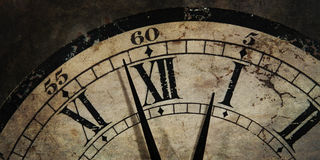 Grunge old Clock showing the Time stock images