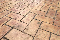 Grunge Old Cracked Brown Brick Stone Street Road. Sidewalk, Pavement Texture Background. Perspective View of Grunge Old Cracked Brown Brick Stone Street Road Royalty Free Stock Image