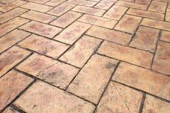 Grunge Old Cracked Brown Brick Stone Street Road. Sidewalk, Pavement Texture Background Royalty Free Stock Image