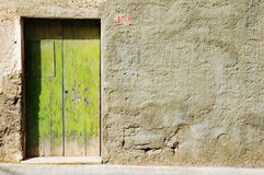 Grunge old green door. Old colorful grungy textured green doorway background Royalty Free Stock Image