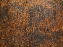 Grunge old leather texture. Close-up of old worn-out leather upholstery Stock Photography