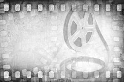 Grunge old motion picture film reel with strips Stock Photo