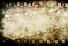 Grunge old motion picture reel with film strip and Royalty Free Stock Photos